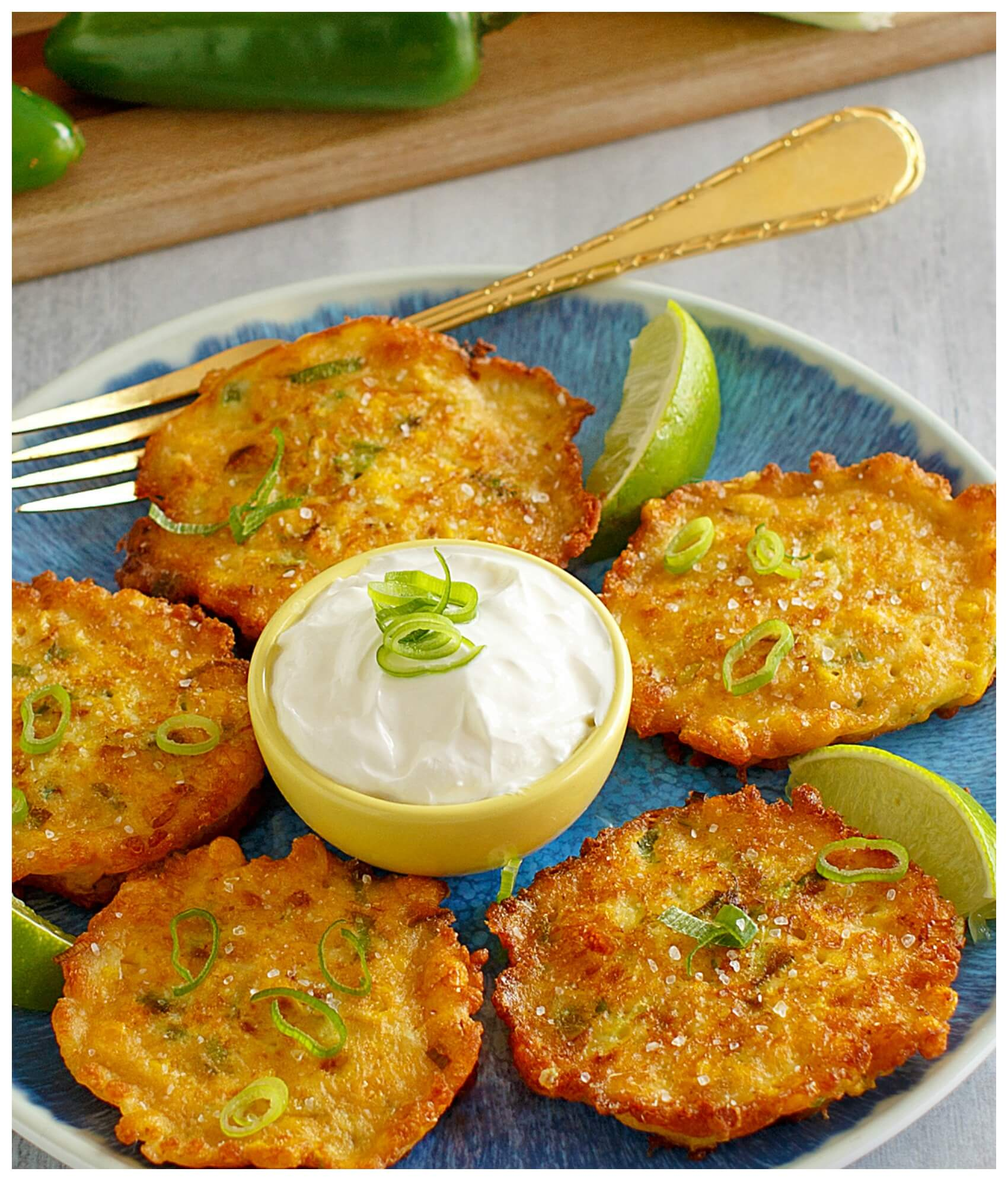 Appetizer of corn fritters with dipping sauce made with canned sweet corn.