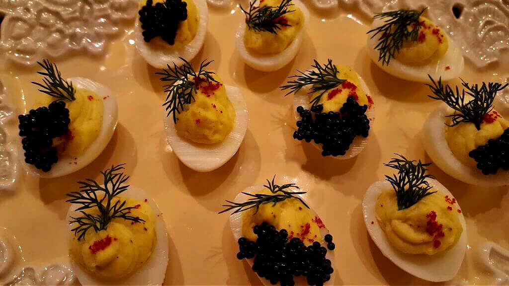 deviled quail eggs on a serving platter