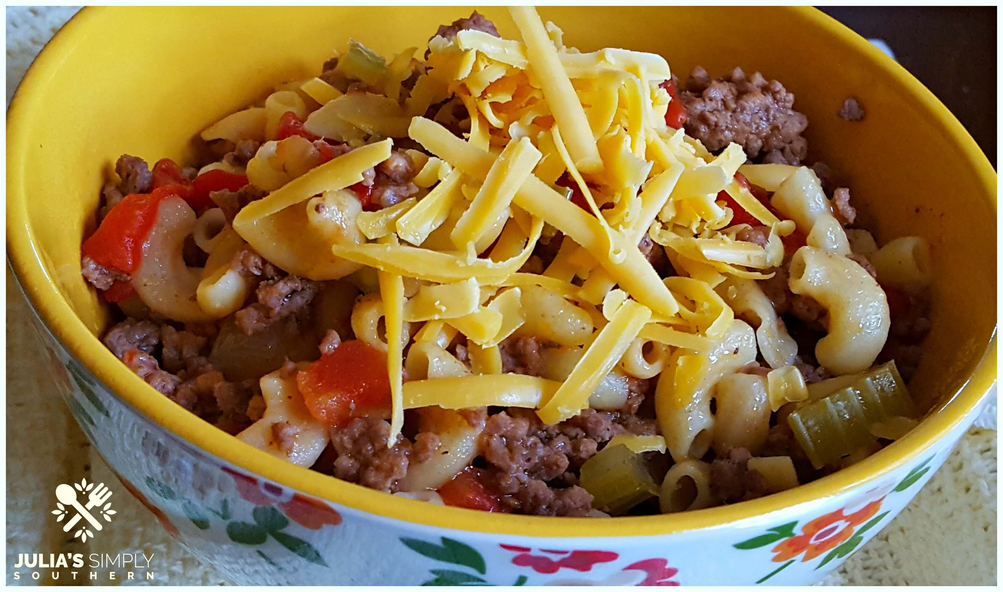 Easy old fashioned goulash - American style topped with cheddar and a few dashes of hot sauce