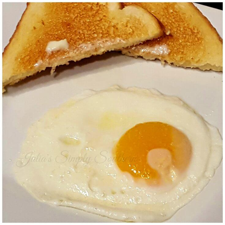 sunny side up egg on a plate with toast