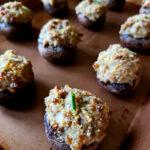 Easy Sausage Stuffed Mushrooms on a 1/4 sheet baking pan with parmesan panko topping