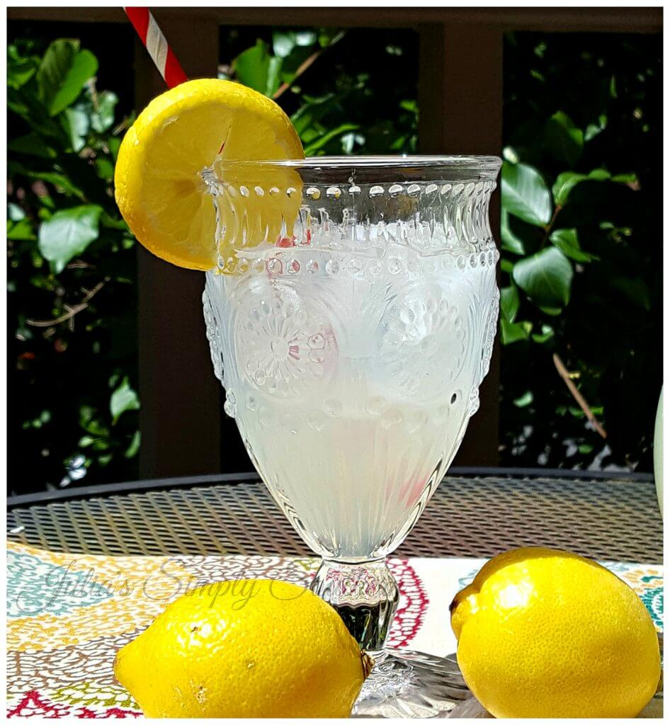 glass of lemonade garnished with a slice of fresh lemon