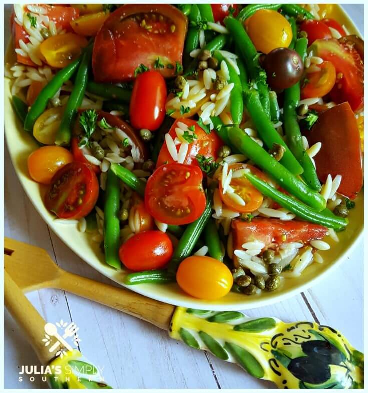 Easy Green Bean and Tomato Salad on a vintage yellow platter with beautiful salad utensils from Italy