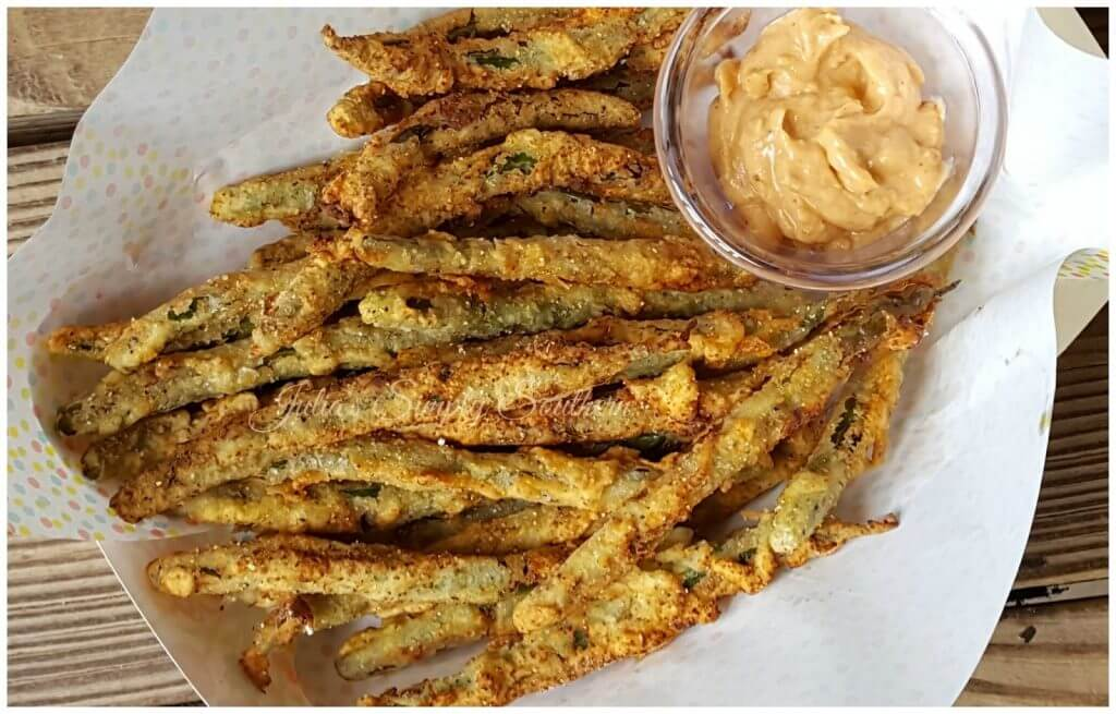 Fried green beans in a serving tray with remoulade dipping sauce