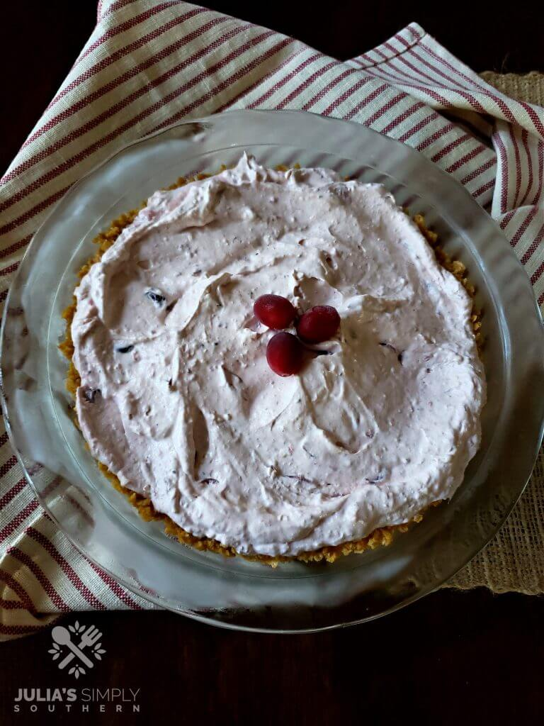 Frosted cranberry pie in a glass pie dish