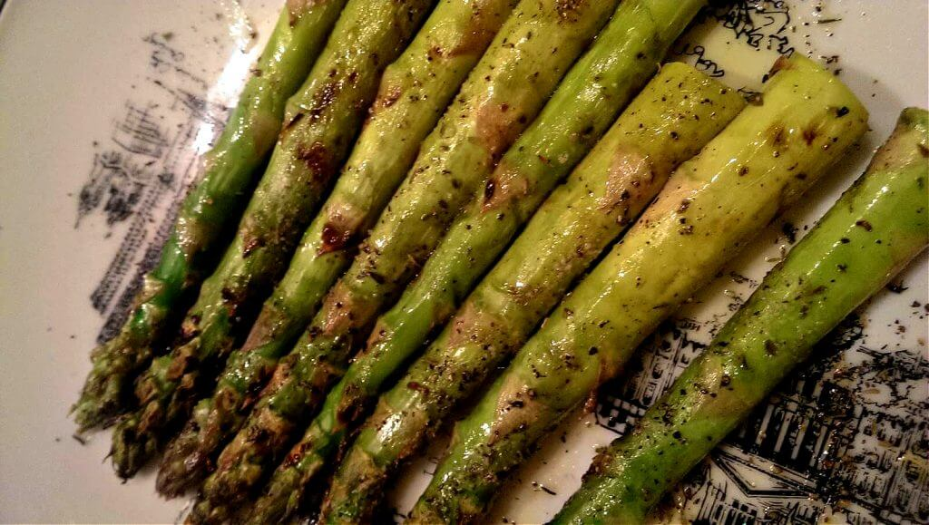 Perfectly grilled asparagus on a serving plate
