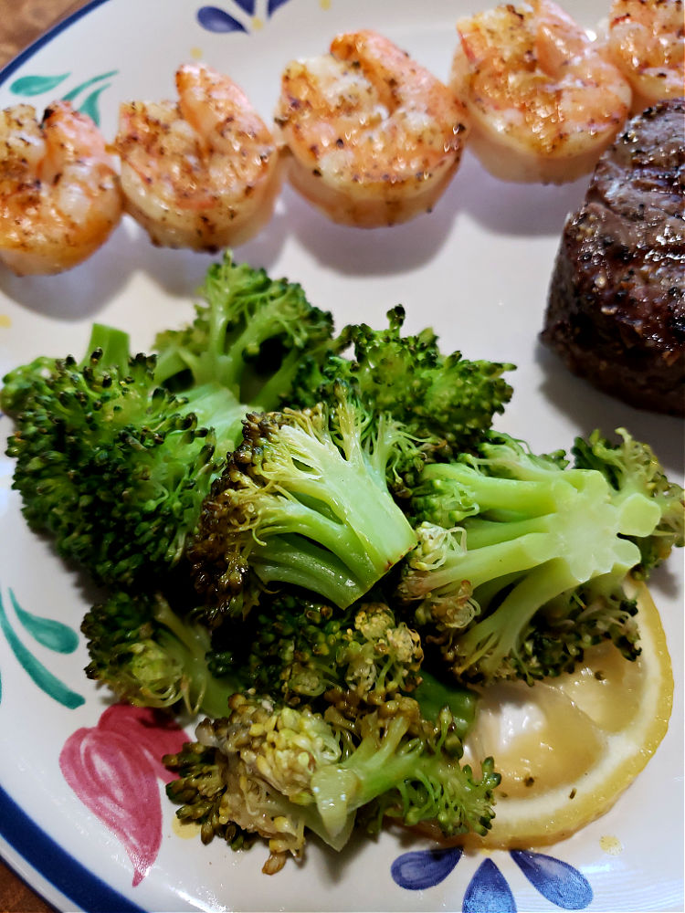 Grilled broccoli served with shrimp and filet mignon