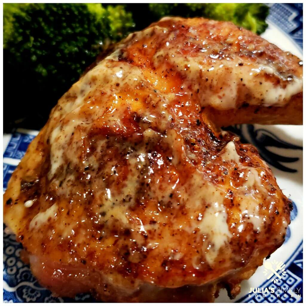 Blue and White dinner plate with a serving of grilled chicken brushed with white barbecue sauce and steamed broccoli