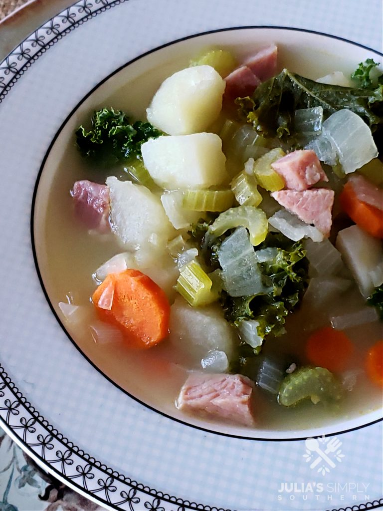 Potato and Kale Soup Recipe with Ham and vegetables in a serving bowl
