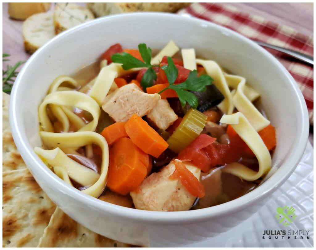 Fresh vegetable, chicken and egg noodle soup prepared in a slow cooker