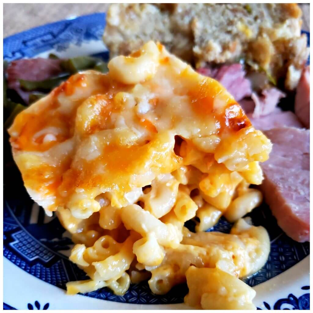 Plate with Southern Macaroni and Cheese served with baked ham and cornbread dressing