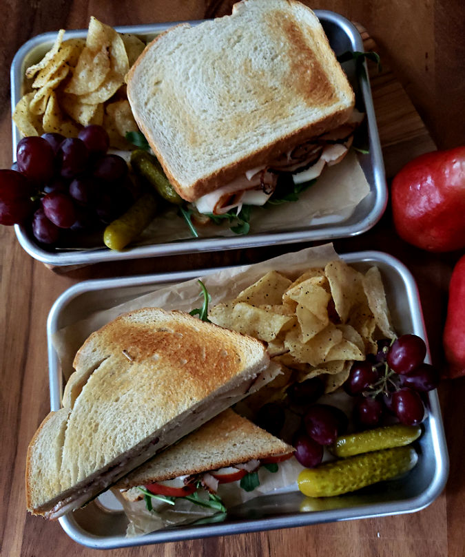 Turkey Sandwiches served with pickle, fruit and chips