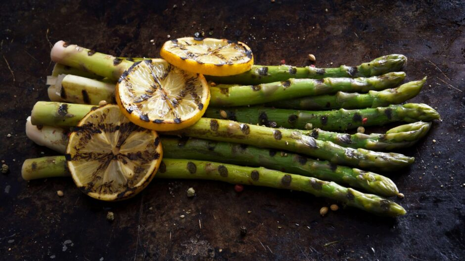 Grilled Asparagus garnished with lemon