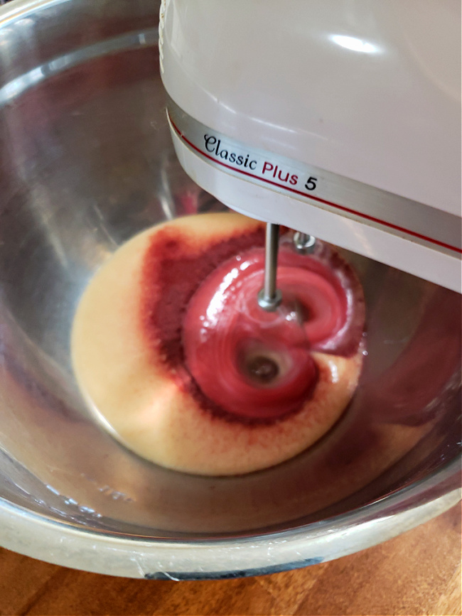 Mixing Kool aid with sweetened condensed milk using a hand mixer