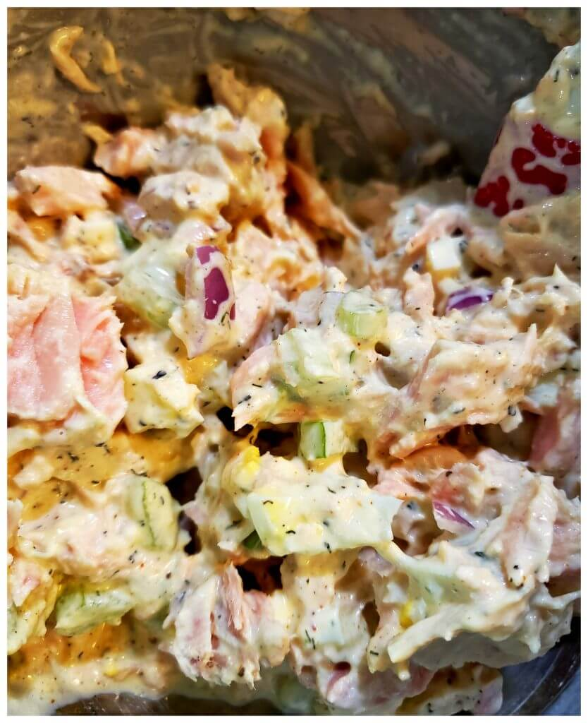 Creamy tuna salad mixture in a mixing bowl