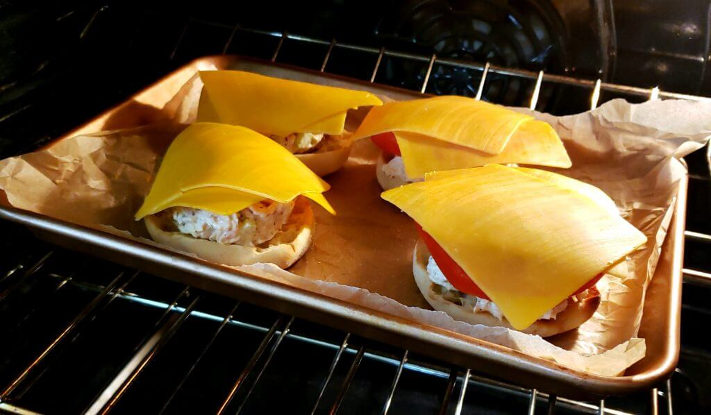 Tuna Melts on a baking sheet in the oven for toasting