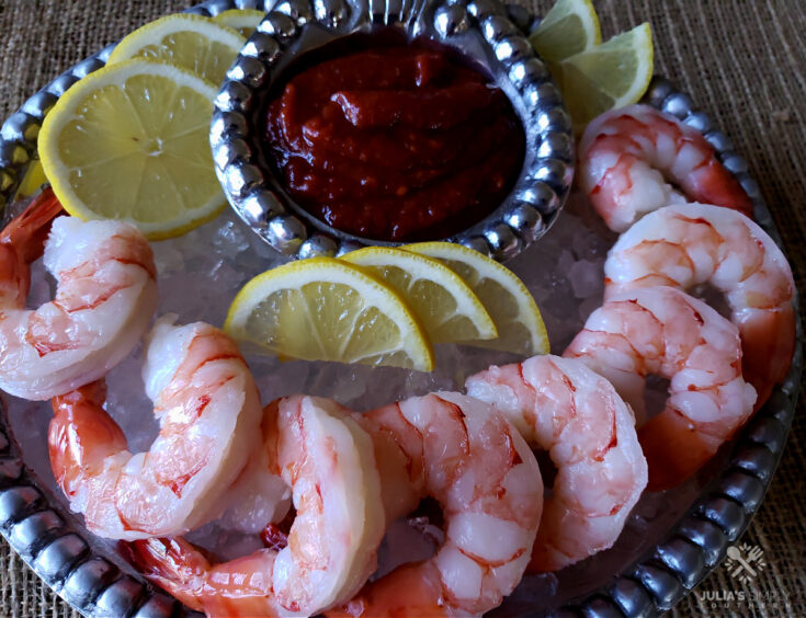 Classic Shrimp Cocktail Sauce Recipe - served on a bed of crushed ice and lemon slices - easy appetizer