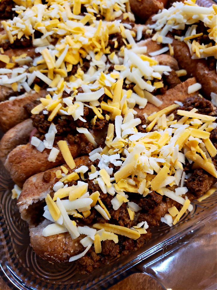 Chili and Cheese Hot Dogs oven baked with cheddar