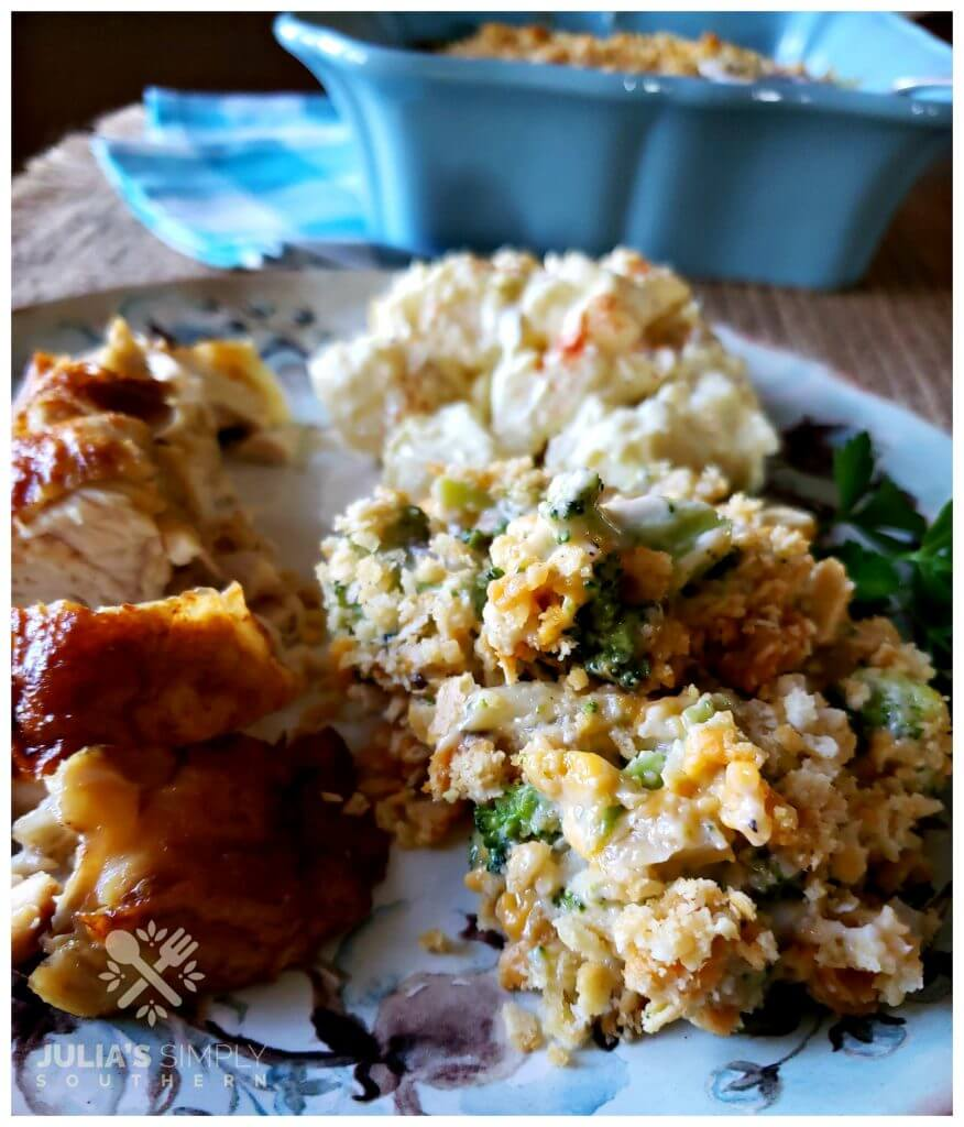 Best Broccoli Casserole recipe on a plate with roasted chicken and potato salad