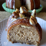 Butter Pecan Pound Cake with Praline Glaze on a white plate