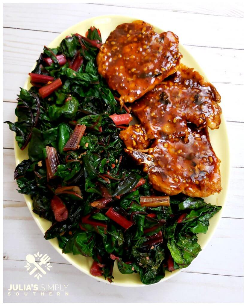 Healthy green vegetable recipe of Garlic Swiss Chard, shown on a platter - a highly nutritious vegetable