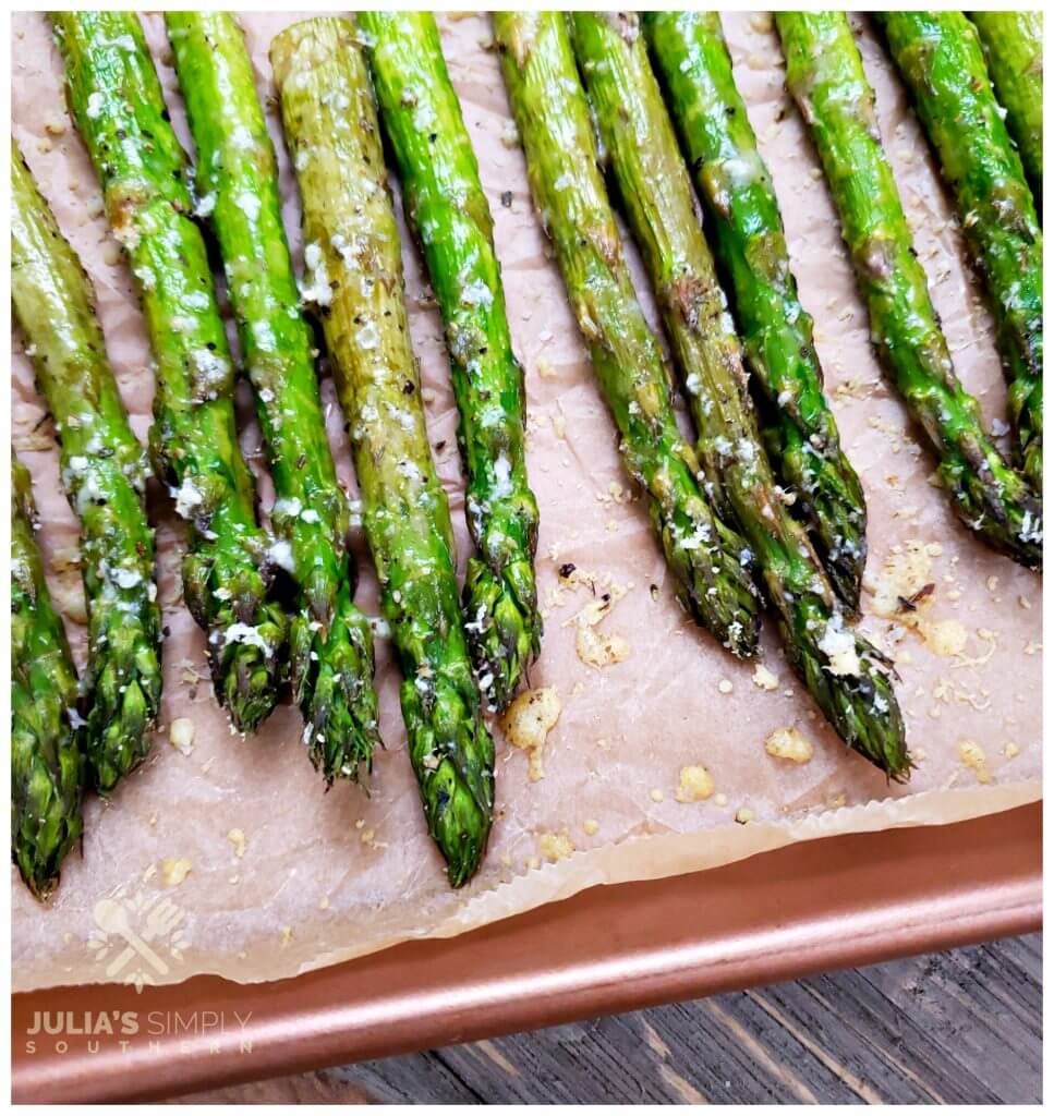 Recipe for roasting thick spears of asparagus seasoned with herbs and Parmesan
