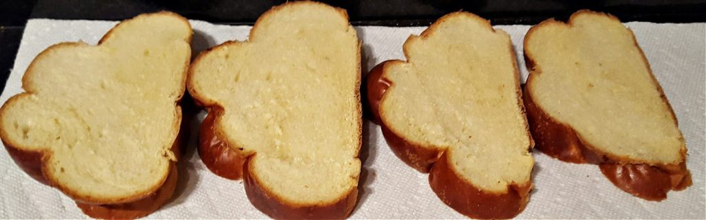 Slices of challah bread drying on a countertop