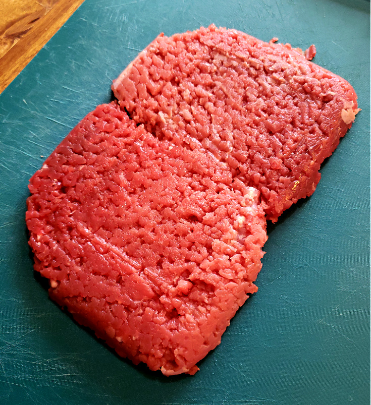 Cubed Steaks - tenderized beef on a cutting board