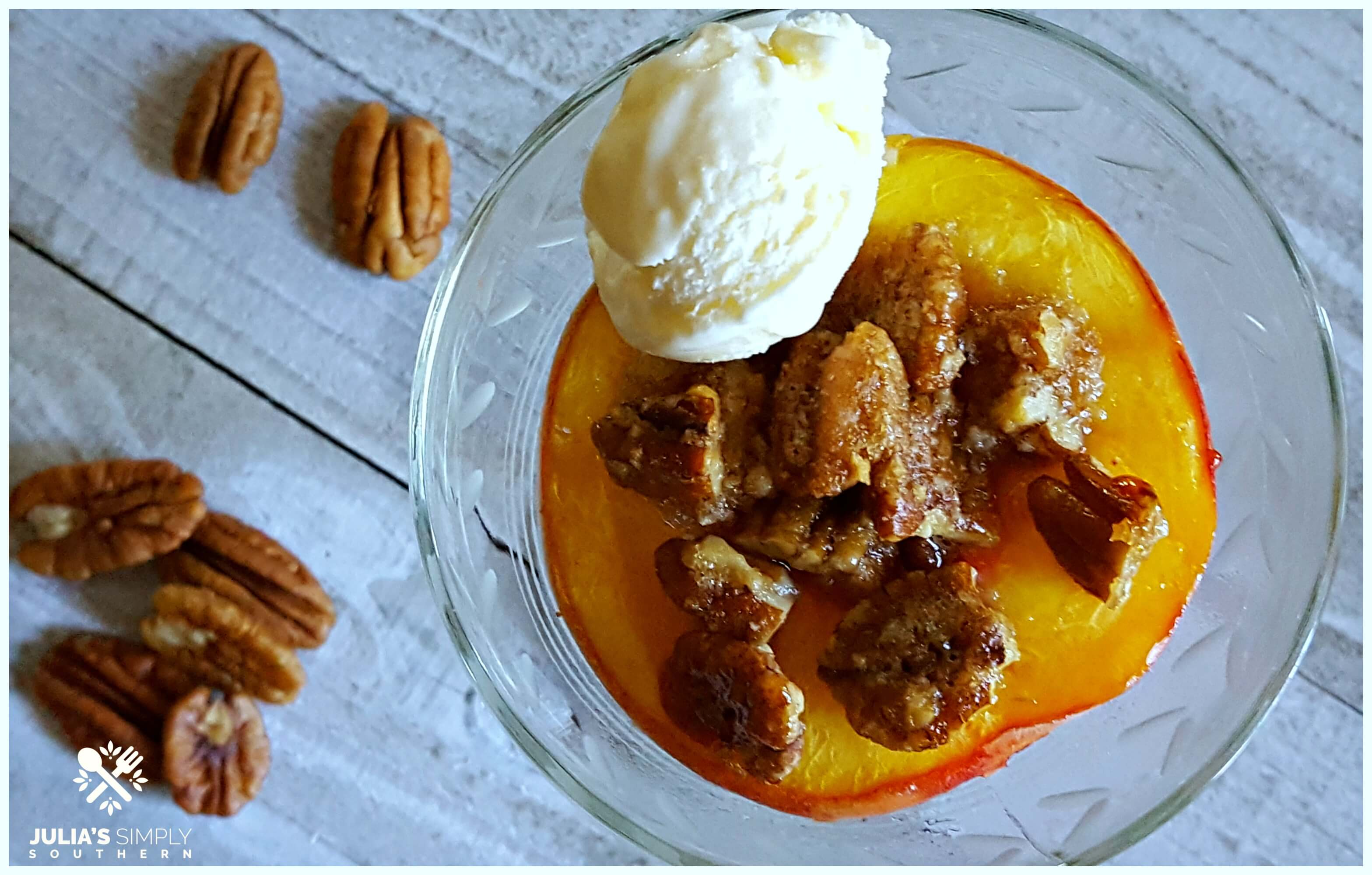 Sophisticated Bourbon Peaches served in a stemmed glass with ice cream