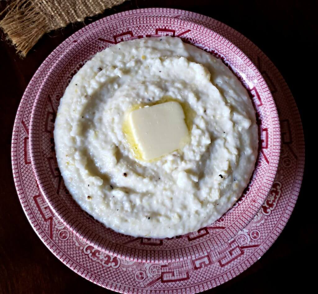Thick creamy delicious grits in a serving bowl for breakfast
