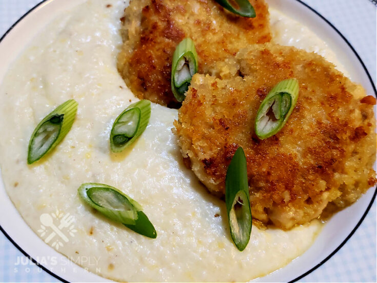 Southern Salmon Patties on a bed of grits garnished with sliced scallions
