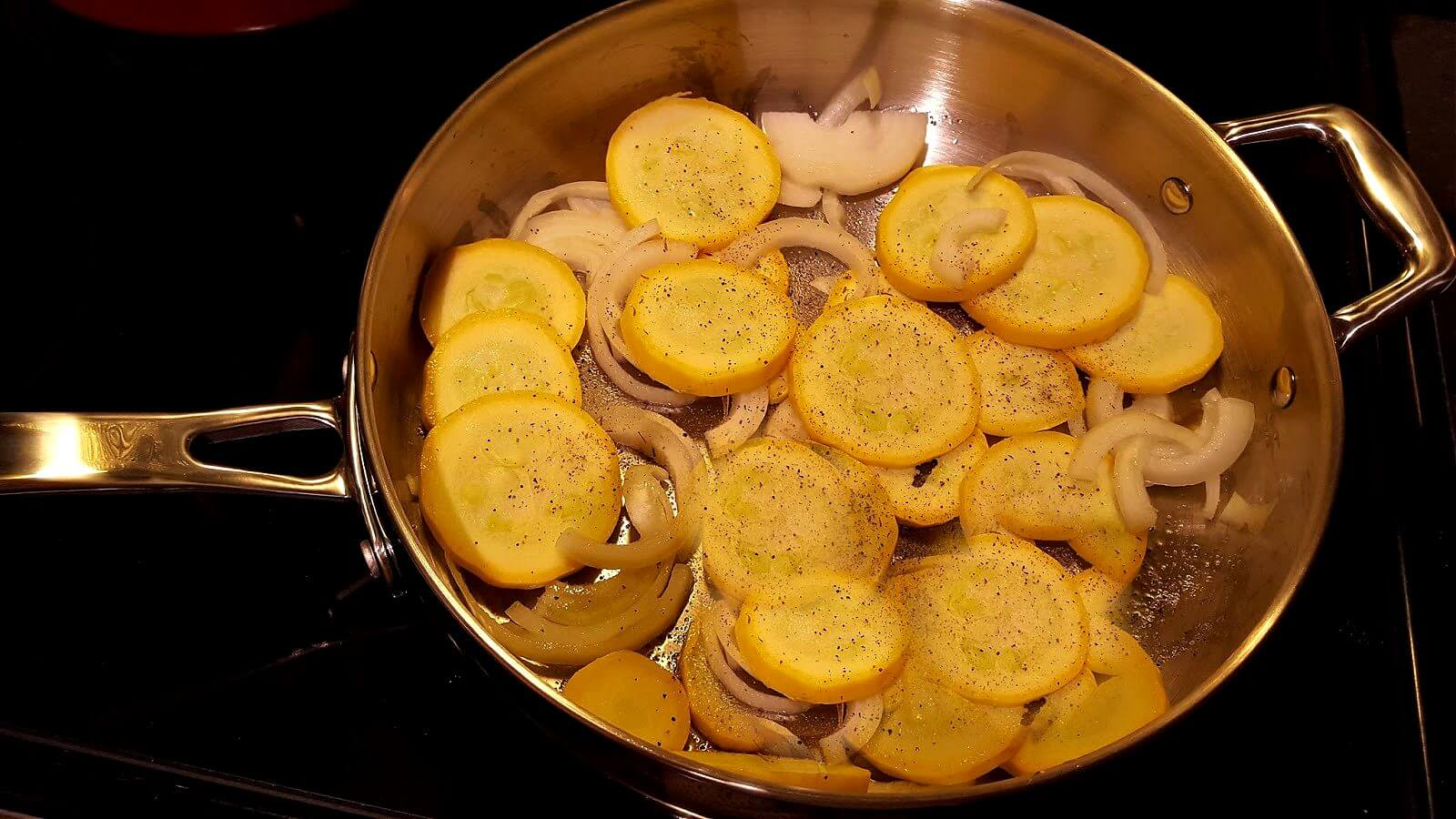 Skillet with yellow squash and onions