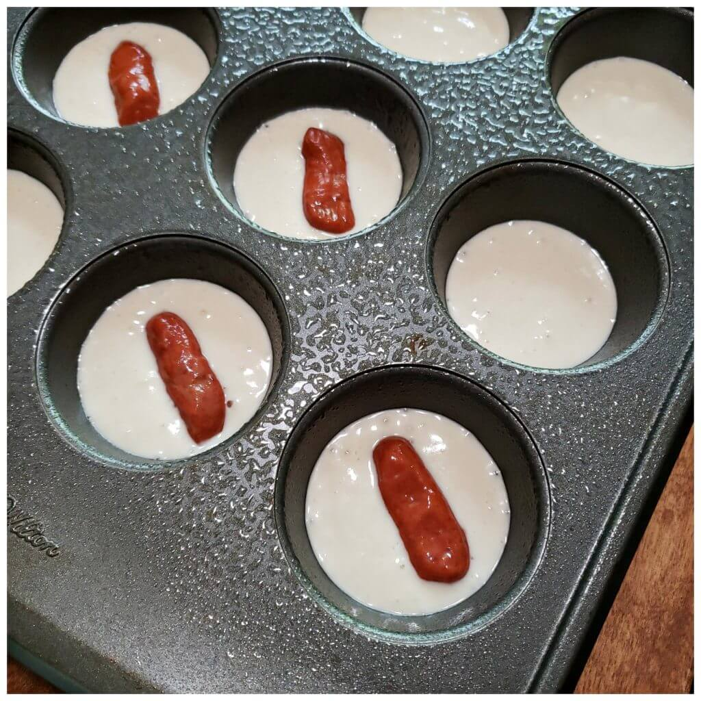 Using a muffin pan to make breakfast piggies - Pancake Pigs in a Blanket