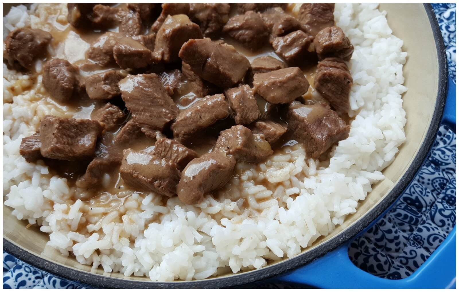 Beef Tips and Rice in a blue enamel cast iron dish