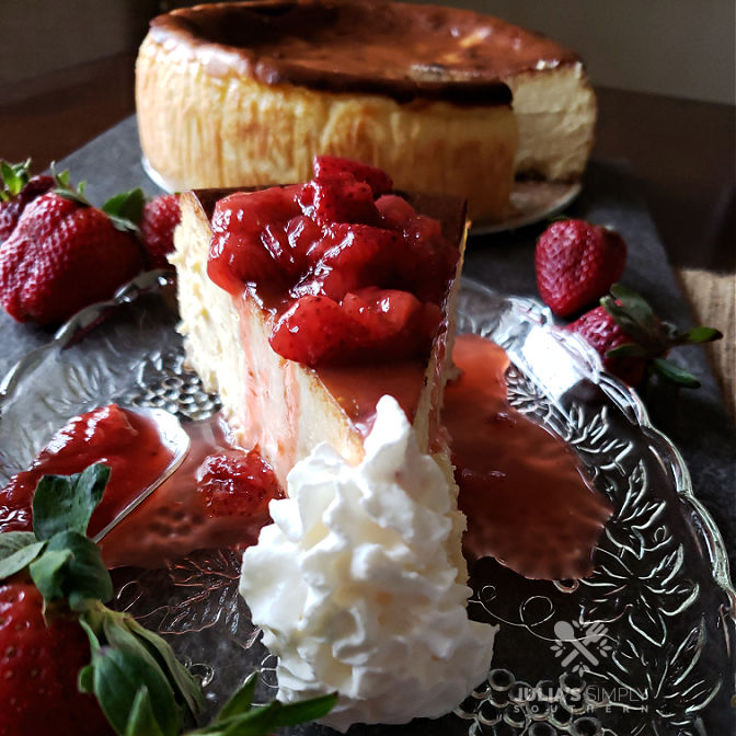New York style cheesecake from scratch with homemade fresh strawberry topping sauce