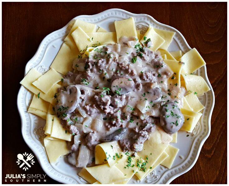 Best beef stroganoff recipe with buttered noodles on a cream plate