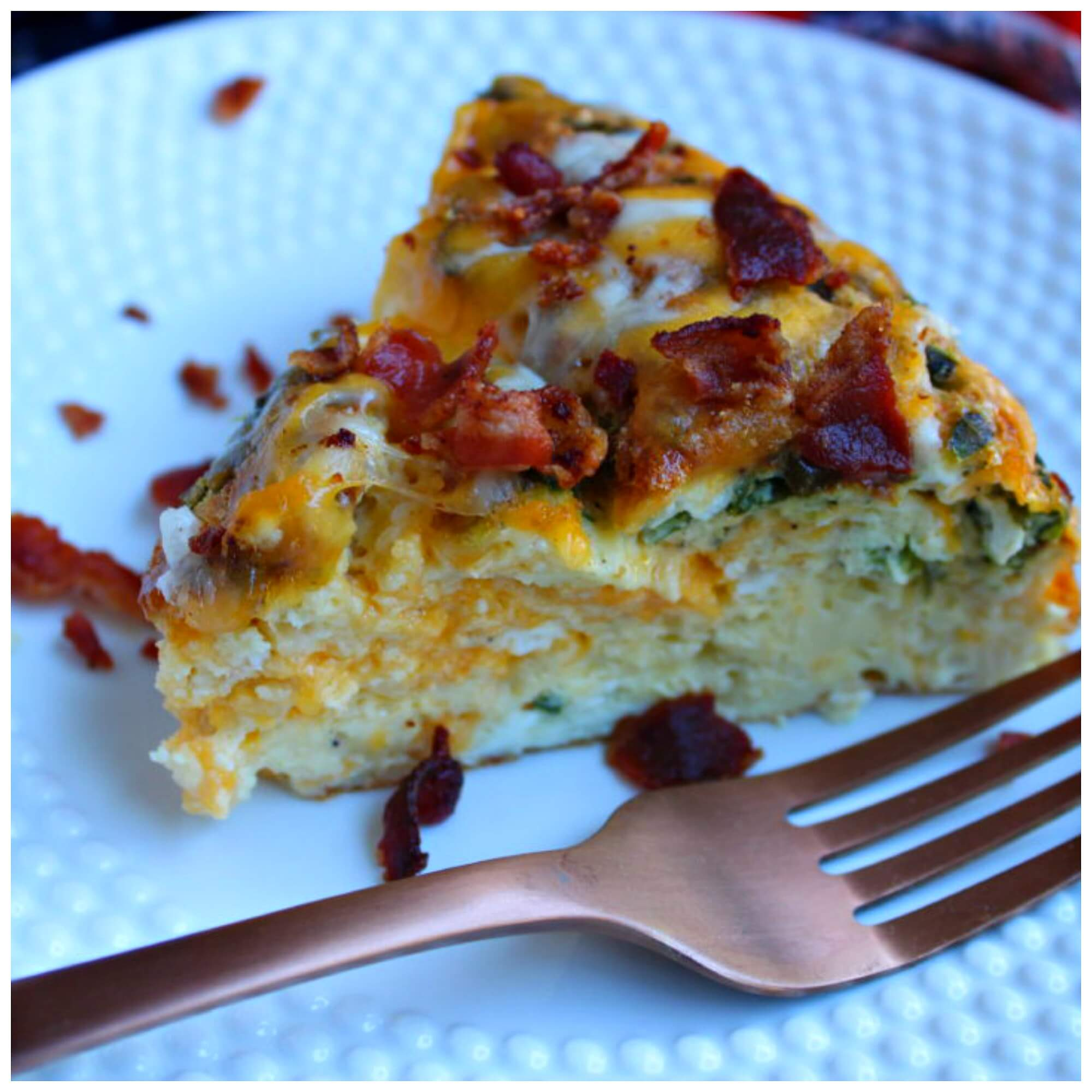Breakfast casserole with bacon on a white plate