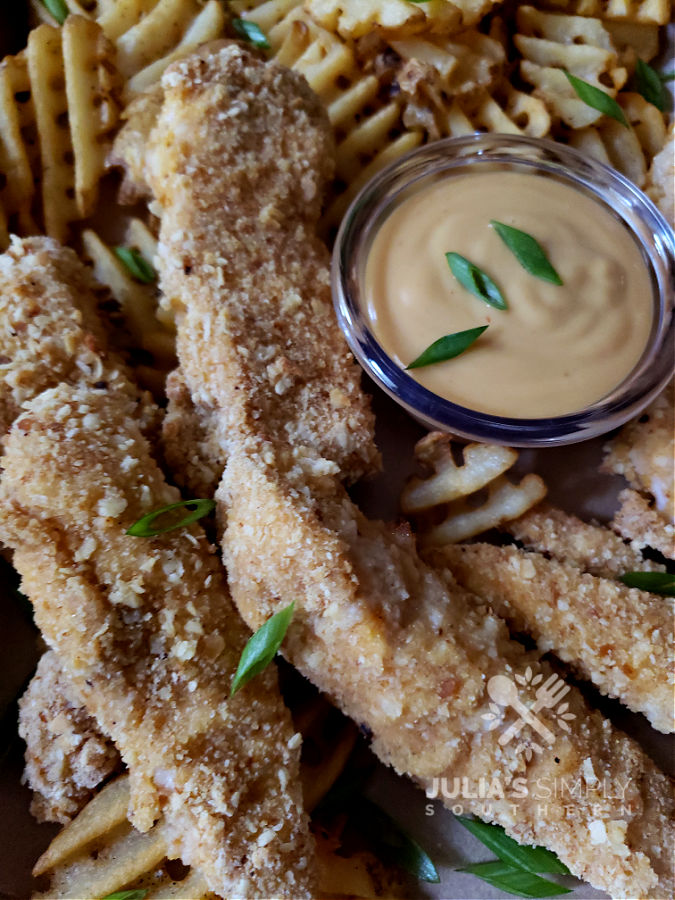 homemade chicken fingers basket with fries. Simple Baked Chicken Tenders Recipe