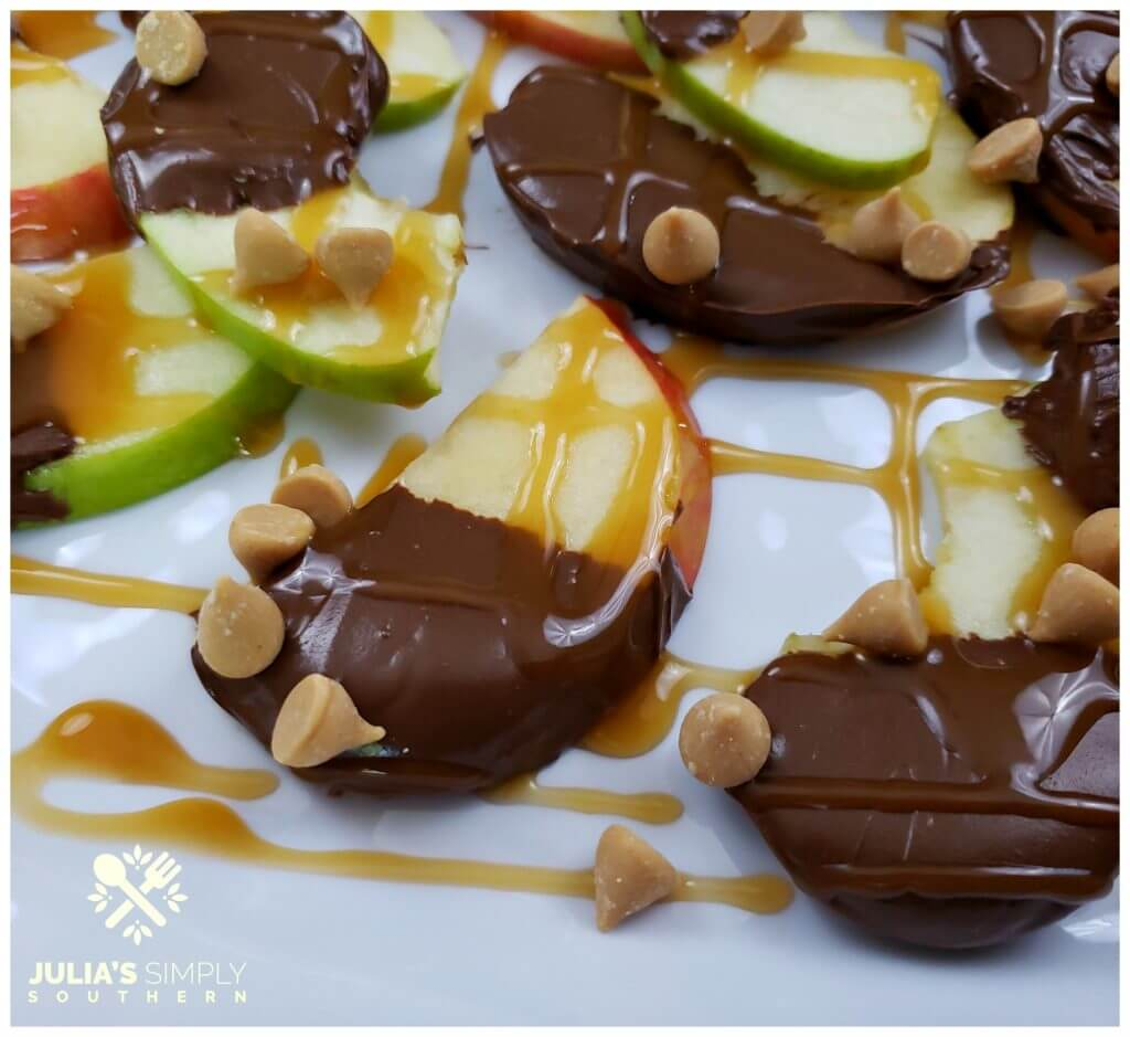 sweet apple nachos with caramel on a white serving platter