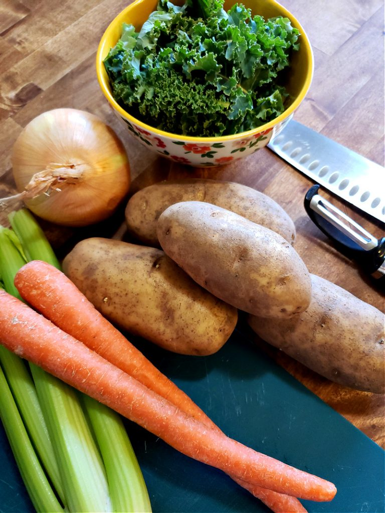 Ingredients to make potato and kale soup