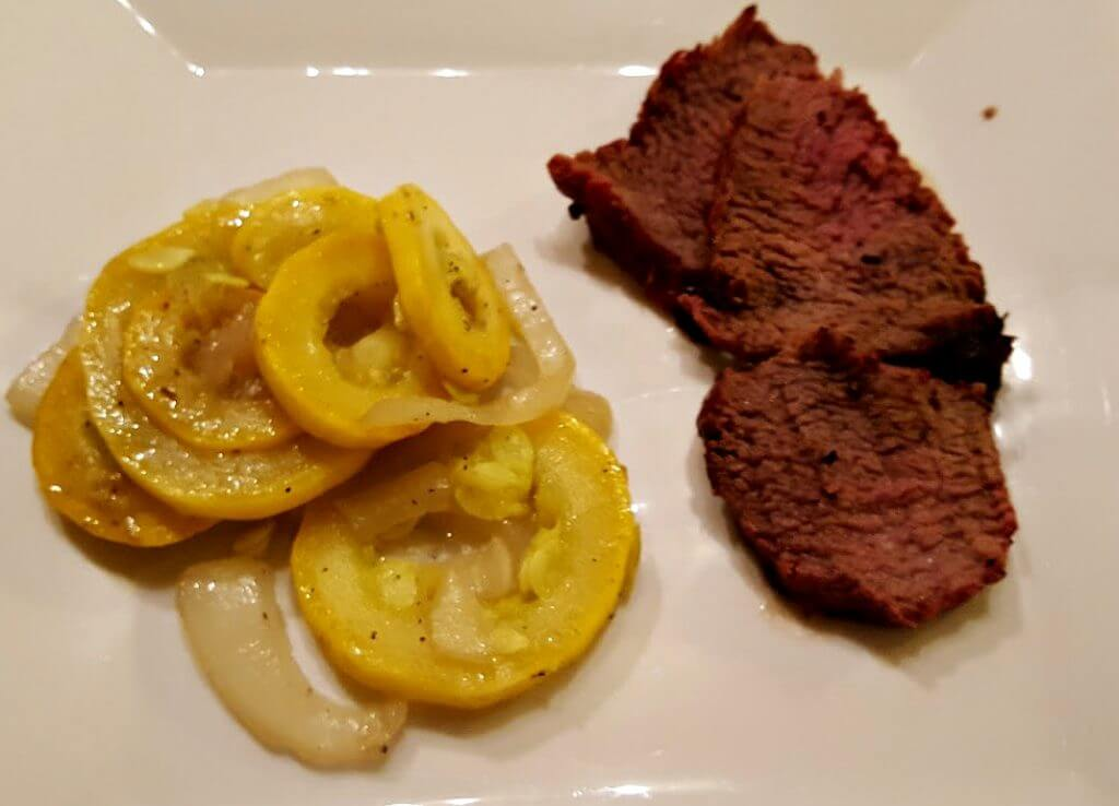 Beef with a side of squash vegetable
